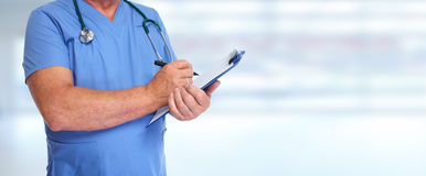 Hands of medical doctor with clipboard. Royalty Free Stock Images