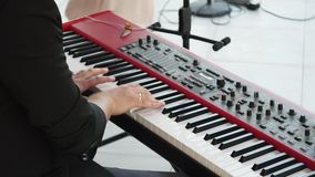 Hands of men play on the synth.  stock footage