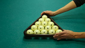 Hands men raise the triangle with balls stock video footage