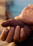 The hands of men resting after a grueling work Royalty Free Stock Images