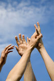 Hands of men and the sky Royalty Free Stock Photos