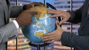 Hands of men touch globe. Two adult businessmen. Discussion of scientists. What future awaits the Earth stock footage