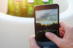 Hands of men are using mobile smart phones Stock Images