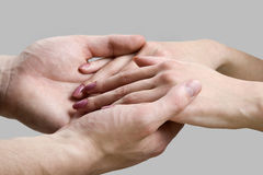 Hands of men and women. Isolated on gray background Stock Images