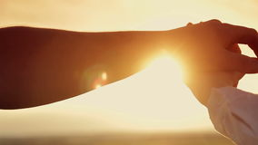 Hands of men and women at sunset. Hands of men  and women at sunset stock video footage