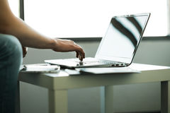 The hands of men working in stylish  laptop Royalty Free Stock Photo