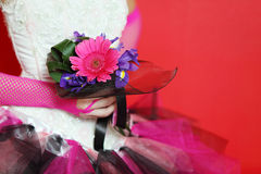 Hands in mesh gloves of bride hold bouquet Stock Photo