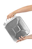 Hands with metal jerrycan Stock Images