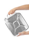 Hands with metal jerrycan Stock Image