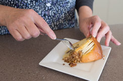 Hands of Middle-aged Woman and Apple and Walnut Cake. Stock Photography