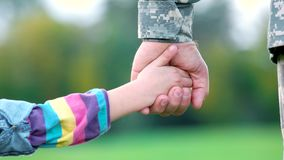 Hands of military father and his daughter. Hands playing of daddy and little girl stock video