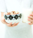 Hands with milk and flakes Royalty Free Stock Photography