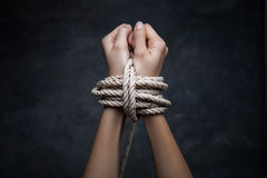 Hands of a missing kidnapped, abused, hostage, victim woman tied Stock Image