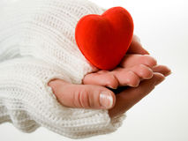 Hands in mittens holding heart Stock Photos