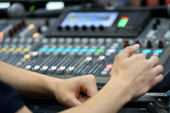 Hands on Mixing Console. Director working on the video or sound mixing console in the studio Royalty Free Stock Photo