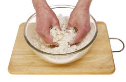 Hands mixing dough Stock Photography