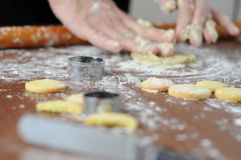 Hands mixing fluor with cookies Stock Image