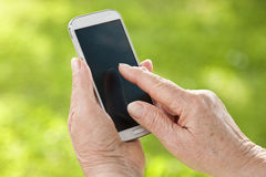 Hands with mobile. Senior hands with mobile phone Royalty Free Stock Photos