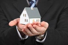 Hands with model of house Stock Photo