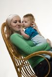 At the hands of Mom. A woman holding a child in her arms Royalty Free Stock Photo