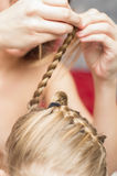 Hands mom braid pigtails. The hands mom braid pigtails daughter Stock Images