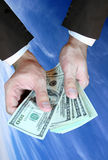 Hands and money. Dollar banknotes in hand with copy space Stock Images