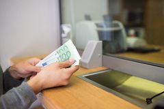 Hands with money at bank or currency exchanger Stock Photos
