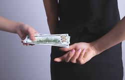 Hands money bribe from behind stock photography
