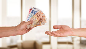 Hands with money Stock Photo
