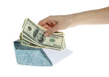 Hands and money in envelope isolated Royalty Free Stock Photo