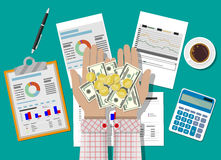 Hands with money and financial reports Royalty Free Stock Images