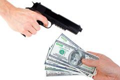 Hands with money and handgun Royalty Free Stock Images