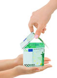 Hands and money house Royalty Free Stock Photography