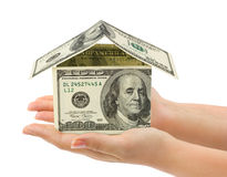 Hands and money house Royalty Free Stock Photos