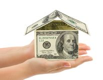 Hands and money house Stock Photo