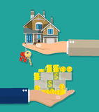 Hands with money house with keys. Royalty Free Stock Images