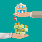 Hands with money and house. Real estate Royalty Free Stock Image