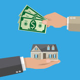 Hands with money and house. Real estate Royalty Free Stock Photos
