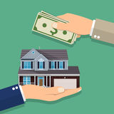 Hands with money and house. Royalty Free Stock Images