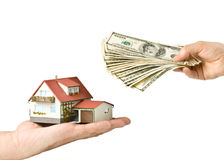 Hands with money and miniature house Royalty Free Stock Photo
