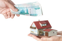 Hands with money and miniature house Royalty Free Stock Image