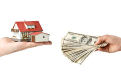 Hands with money and miniature house Stock Image