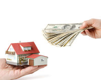 Hands with money and miniature house Royalty Free Stock Photos