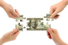 Hands and money puzzle Stock Images