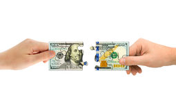 Hands and money puzzle Royalty Free Stock Photos