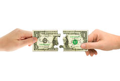 Hands and money puzzle. Isolated on white background Royalty Free Stock Photo