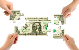 Hands and money puzzle Stock Photography