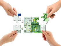Hands and money puzzle. Isolated on white background Stock Photo
