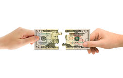 Hands and money puzzle Royalty Free Stock Image