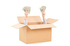 Hands with money raising from a box Stock Photos